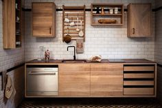 The Railway components, which hang on a wall-mounted rail, have a Shaker-like flexibility. The rail is the only part of the kitchen that's fixed, which means that cabinets can be moved according to changing needs.
