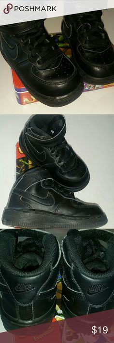 Children's Nike Sneakers Sz 7C Black Nike high top sneakers. Sz 7C  Lace up, black, strap shoes. Gemtly used, normal wear. Great condition. No holes. Some lint pilling on the strap part. Shoes Sneakers