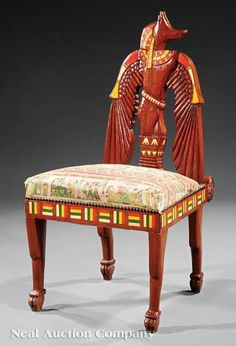 An Egyptian Revival Bone Inlaid Hardwood Side Chair, late 19th/early 20th c., back carved as a stylized winged Anubis, square seat, tapered legs, height 27 in.