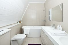 Interesting narrow bathroom configuration to include a floating tub