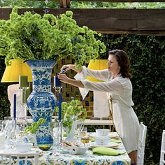 in love with oversized vase center pieces and lamps with colorful lamp shades at an outdoor dinner party
