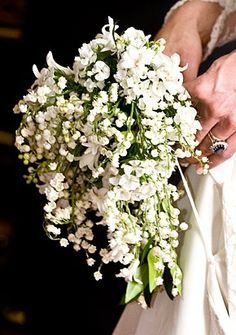"Kate's bouquet: Comprised of a shield-shaped wired bouquet of myrtle, lily-of-the-valley and hyacinth, the bouquet ""draws on the traditions of flowers of significance for the Royal Family, the Middleton family and on the Language of Flowers,"" according to a statement released on the Official Royal Wedding Web site."