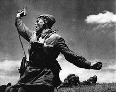 Aleksey Gordeyevich Yeremenko, was recognized by his wife and children when they saw the photograph in Pravda. It remains one of the most iconic photographs of World War II. Yeremenko was a junior political officer serving with the 220th regiment of 4th Rifle Division. On July 12, 1942, the commander of his regiment fell during battle. Rallying his troops to the attack, Yeremenko stood and waved them on. Seconds after this photograph was taken, Yeremenko was shot dead.