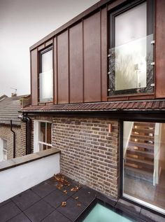 Copper-clad roof extension to east london flat by Poulsom Middlehurst Zinc Cladding, Exterior Wall Cladding, Extension Veranda, Roof Extension, Extension Ideas, Zinc Roof, Copper Roof, Copper Wall, Attic Renovation