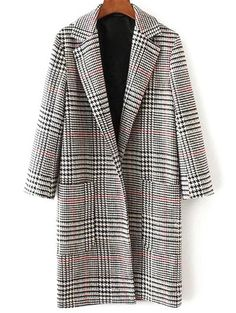 This houndstooth coat would be perfect over an all-black outfit with a pair of red heels, or perhaps a red bag!