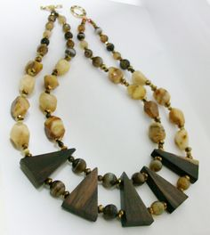 Agate, crystal and Bali wood. Find me on Facebook @ Granate27 cr