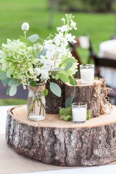 Rustic Farm Wedding Tree Trunk Centerpieces Candles Moss Flowers