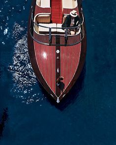 Give her a classic wooden Chris Craft, and a fedora wearing pilot at the helm.