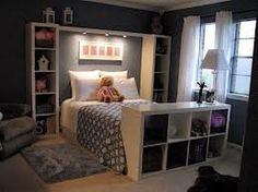 LOVE the shelving @ top of bed.. Bins in very bottom, next up books, then pics--C
