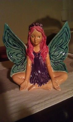 Lotus Fairy.  Painted this at the pottery place with my wife.