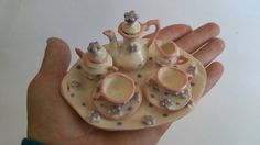 Check out this item in my Etsy shop https://www.etsy.com/listing/265196862/miniature-flower-tea-set-in-pink-purple