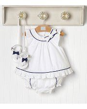 Ruffle Pretty    Summer ruffles. Indulge your little one in our dainty poplin ensemble with ruffly bloomer featuring retro-inspired button accents. Matching crib sandal sold separately.