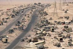 "The ""Highway of Death"" after American warplanes caught retreating Iraqi forces in the open in the Gulf War of 1991 against Iraq."