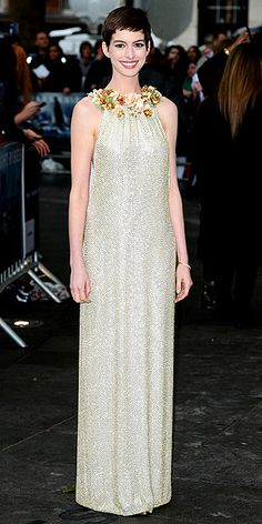 shimmering golden Gucci gown with a floral neckline, worn with Tiffany gems and Casadei heels.