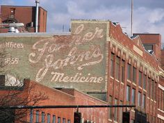 Father John's ghost sign by wemcg via Flickr