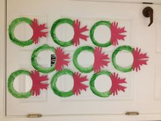 Paper plate wreaths with handprint bows.
