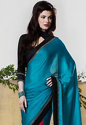 Ultimate collection of embroidered sarees with fabulous style. This teal blue and dark pink chiffon jacquard saree have beautiful embroidery work which is embellished with stone and patch border work. Fabulous designed embroidery gives you an ethnic look and increasing your beauty. Contrasting black blouse is available. Slight Color variations are possible due to differing screen and photograph resolutions.