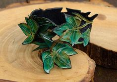Beautiful made to order Hand made carved leather Fairy cuff Bracelet featuring a hand carved and colored Ivy leaf design by crowman, $66.59 USD