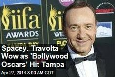 "Latest News:  Spacey, Travolta Wow as ""Bollywood Oscars"" Hit Tampa.  The Indian film industry's top award show sailed into Tampa, Florida, yesterday with a pirate-themed opening musical number and celebrities ranging from Slumdog Millionaire star Anil Kapoor to John Travolta and Kevin Spacey.  Get all the latest news on your favorite celebs at www.CelebrityDazzle.com!"