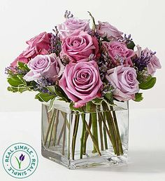 Elegant and soft, this bouquet looks like it came fresh from the garden. Lavender and purple roses mingle in a stylish clear rectangular vase. The delicate floral color palette and modern container make for a striking combination you'll want to put prominently on display.