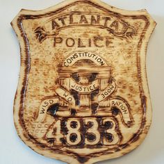 New Item.  Now making wood carved and burned police badges.