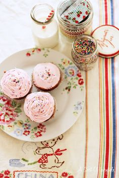 Rosewater cupcakes.  Cath Kidston.  Sprinkles.  Vintage tea towels.  So in love!!