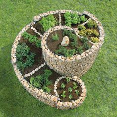 Herb Spiral using wire and stones for the walls