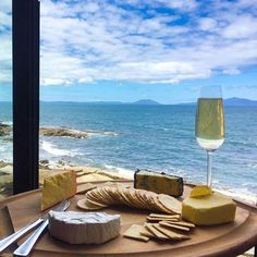 enjoying a stunning view of the Freycient Peninsula from Thalia Haven in Discover Tasmania, whilst indulging in Ninth Island sparkling and a selection of great Tassie cheeses - including her favourite from King Island Dairy.