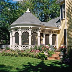Attached Gazebo with Porch Extension Because of their odd shape, gazebos attached directly to homes often require a transition to make the connection work. In this case, a small porch extension does the trick. The scrollwork trim echoes just a few elements on the house instead of being an exact style match.