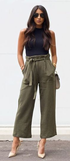 Pretty outfit for spring and summer with green pants and black top
