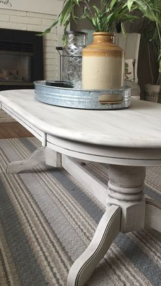 "$200  Modern Farmhouse Pedestal Coffee Table.  There are coffee tables and then there are Modern Farmhouse coffee tables.  This solid oak oval beauty was refinished in antique white and black glaze, and did you see those 2 pedestal legs??  Wow...A truly classic Modern Farmhouse beauty.   Measurements:   24"" W x 17"" H x 54""L( from centre of top) to   Available now at Simply Vintage  https://m.facebook.com/simplyvintageygk/"