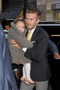 Heading to mom Victoria Beckham's fashion show with dad David in New York in 2014. See all of Harper Beckham's cutest looks.