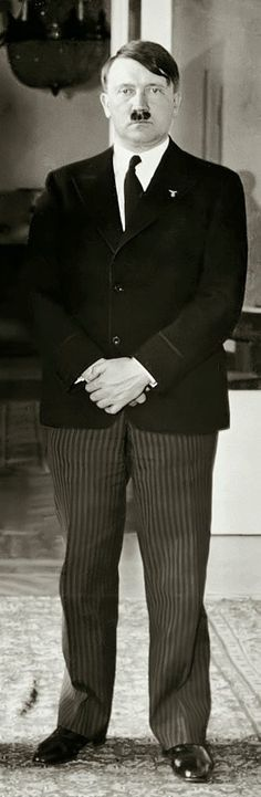 Hitler committing multiple fashion faux pas: a too-short jacket with his dreaded striped pants and shellacked shoes. This is February, 1933 in Berlin. He dumped the striped pants and single-breasted jacket by late 1933.