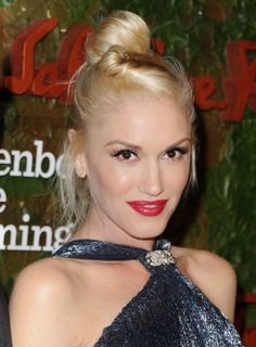 In 2013, Gwen thinned out the black liner, and amped up the false lashes. And went with a berry red lip over the usual true red!