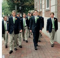The groomsmen wore their own navy blue blazers with white forward-point dress shirts. They sported matching dress trousers and green-and-white striped ties from Brooks Brothers, which were a gift from Kevin.