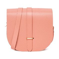 saddle bag by Cambridge Satchel. This scaled down Cambridge Satchel saddle bag is crafted in pebbled leather. Unlined interior. Adjustable shoulder st...