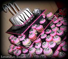 Zebra stripes and hot pink ~wedding cake and cupcakes!  www.samantha-sweets.com #zebra #cupcakes