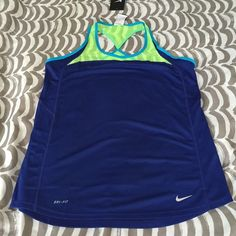 Nike Dri Fit Tank Top Brand new. Loose fit tank top with bright colors for running and any type of work out. Please give me an offer if interested. Nike Tops Tank Tops