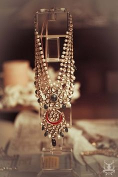 Indian Wedding Jewelry - Polki Jadau Rani Haar | WedMeGood Four layer Polki Kundan Jadau Rani Haar with Black and White Pearls and Meenakari work. #wedmegood #pearls #meenakari #polki #kundan #necklace #jewelry