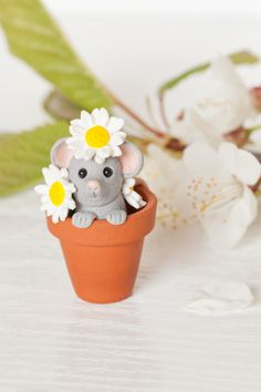 What a cute mouse popping it's head up with a cheeky smile while playing among daisies. Surrounded by individually handcrafted daisies the little mouse grasps the edge of the plant pot, smiling up at you while its tail curls out over the back. Cute Mouse, Unique Presents, Salt Dough, Pet Gifts, Polymer Clay, Delicate, Etsy Shop, Hedgehogs, Daisies
