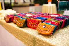 Did you know that giving out colourful bangles is not the only option you have? YES! Mehendi favours have gotten funky, and the list these days is endless. From gota maang tikkas to embellished headbands, and pocket squares for the boys - you can find an exciting favour your guests will not just chuck in their cupboards never to use again. We've put together a list of every single mehndi favour idea that exists for Indian weddings (that our team agreed were genuinely useful) so all you ne...