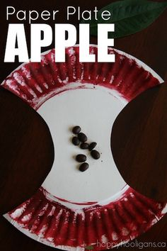 """An adorable paper plate apple craft for toddlers and preschoolers. Using coffee beans for """"seeds"""" adds a fun sensory element to this easy craft. - Happy Hooligans"""