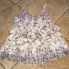 Flowing tank Cream with purple and charcoal black pattern flows polyester ya k with adjustable straps. CAbi Tops Blouses