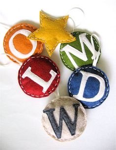 """Felt Monogram Ornaments from Dana@MADE: With Christmas approaching (rather quickly) the words simple, handmade keep coming to mind. Because nothing says Merry Christmas, or """"thanks for being you"""" like a handmade gift. So here's a simple gift to make and give. A, B, C family ornaments. Creating a gift for an entire family is a tricky one. But everyone seems to love ornaments."""