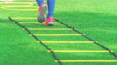 Active Football Child feet with soccer boots training on agility speed ladder in green soccer training ground. Athletic Training, Soccer Training, Soccer Boots, Agility Training, Brunette Woman, Professional Football, Outdoor Workouts, Track And Field, Outdoor Photography