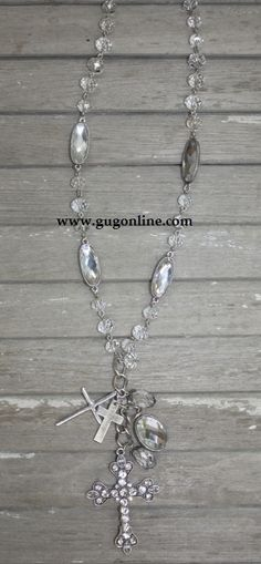 Long Strand of Clear Crystal Beads with Crystal Cross Dangle $19.95 www.gugonline.com