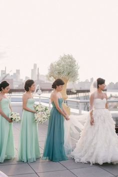 Maid of honor wears a different shade of the bridesmaid...love these colors!