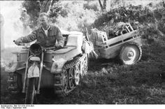 "German soldier driving a ""Kettenkrad"" with tow trailer. Italy, September 1943"