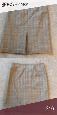 Brown and orange plaid skirt Back zipper. Fully lined. 65% polyester 35% rayon Casual Corner Skirts
