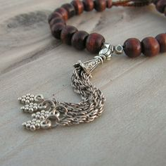 Gypsy Mala Bracelet -  Wood with and Metal Tassel with Vintage Tribal Button. $22.00, via Etsy.